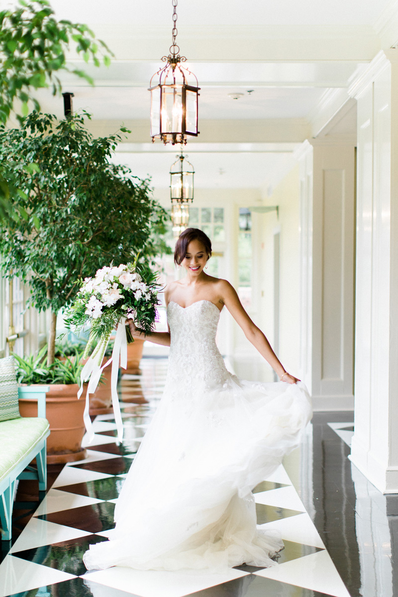 Twirling-bride-in-a-srapless-A-Line-Wedding-dress-by-David-Tutera-from-Savvi-Bridal-in-Durham-at-The-Carolina-inn-for-Southern-Bride-Groom-by-Bronwyn-Duffield.jpg