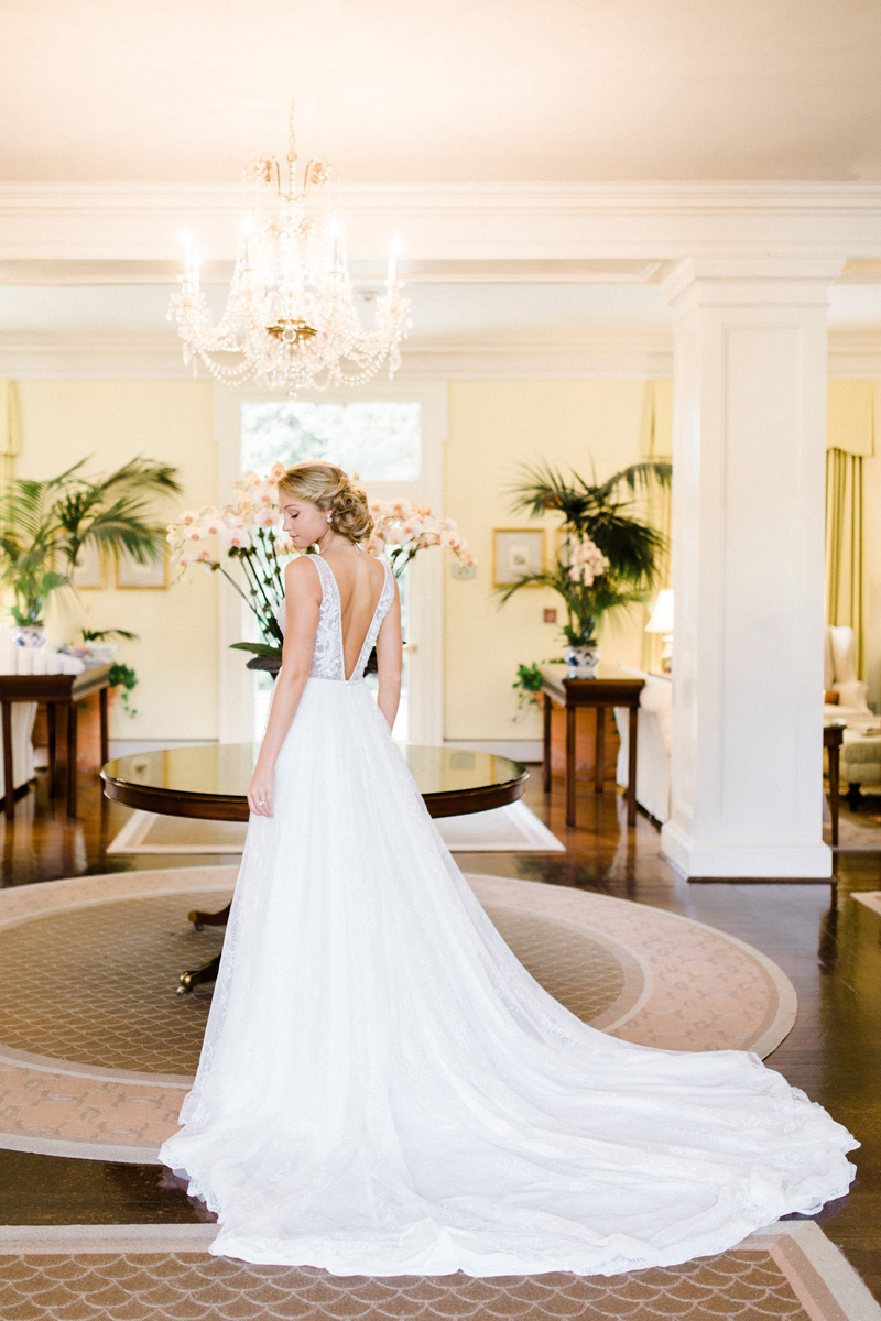V-Shaped-Low-Back-Wedding-gown-by-Flora-from-Raleigh-Bridal-Shop-Alexias-photographed-at-The-Carolina-Inn-for-Southern-Bride-Groom-Magazine-by-Bronwyn-Duffield.jpg
