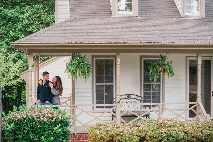 Stephanie of A Style of HEr Own blog and husband embrace on front porch, Fancy This
