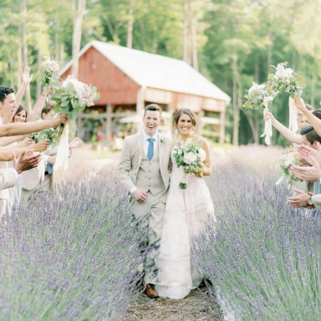 Bride and Groom Walking through Lavender Oaks Farm Fields of Purple Chapel Hill NC Wedding Venue Barn Adelyn Boling