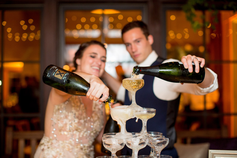 Bride and Groom pouring champagne fountain at NC wedding reception bartending services in Raleigh Durham NC Katherine Miles Jones
