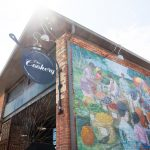 Outside mural and sign of The Cookery, venue in Downtown Durham