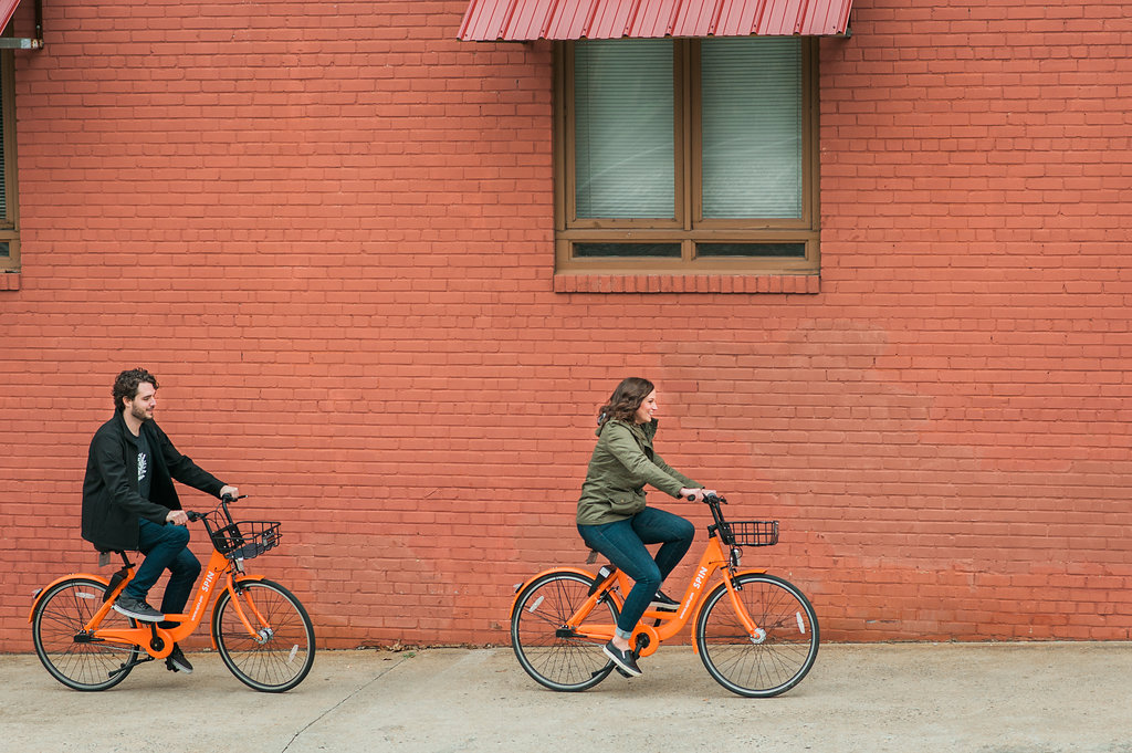 Engagement Shoot on Spin Bikes in Downtown Durham on Southern Bride and Groom blog by Fancy This NC Film Photography