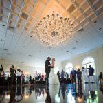 Couple dancing under chandelier in ballroom of Garden on Millbrook