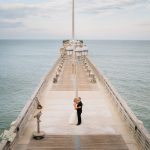 Couple kissing in OBX on Jennettes Pier