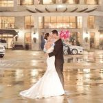 Couple outside of wedding at Renaissance Raleigh kissing