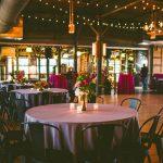 Rickhouse wedding with glass wall in backdrop Carolyn Scott