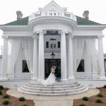 Couple posing in front of grand wedding mansion, River Forest
