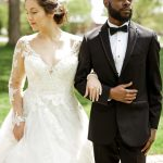 Bride in V Neck lack ballgown from Savvi Formalwear and groom in traditional black tux, richard barlow2