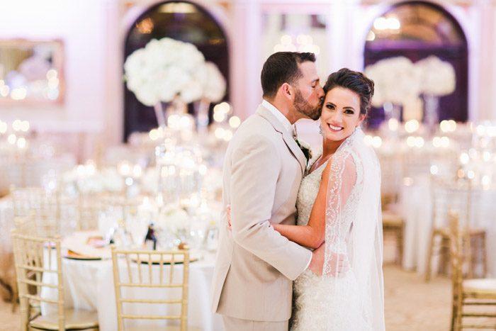 Couple embracing in Grand Marquis Ballroom Wedding, Amanda and Grady Nichols
