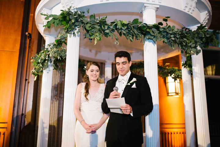 Bride and Groom speak at Carolina Club wedding under the UNC Old Well replica during Chapel Hill wedding reception Anagram Photo