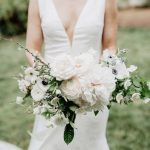 Bride in Deep V wedding gown and white wedding bouquet by Bowerbird Flowers, Brett and Jessica