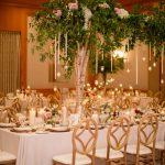 Long-Wedding-Reception-Table-with-Hanging-Greenery-at-The-Umstead-Hotel-and-Spa-planned-by-A-southern-Soiree-Katherine-Miles-Jones