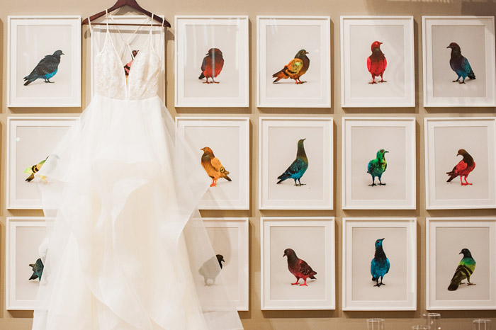 Hayley Paige gown from Tre Bella hangs over a gallery wall of art at Counting House 21c Durham wedding by Fancy This Photography