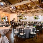 Market Hall warehouse wedding venue in Downtown Raleigh City Market with CE Rental linens Sally Oakley Weddings and flowers by Watered Garden Florist f8 Photo Studios