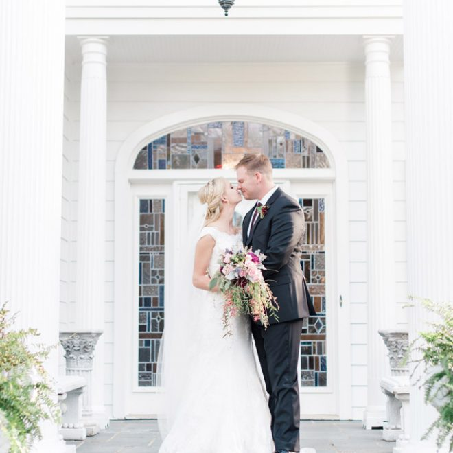 Bride-and-Groom-pose-at-The-Matthews-House-downtown-cary-wedding-venue
