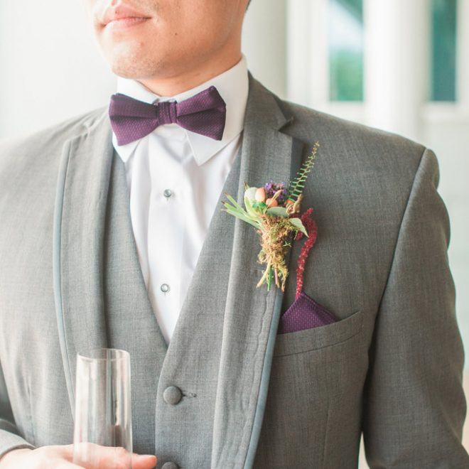 Handsome Groomsman in Grey Tux with Purple Bow Tie and Cocktail Glass