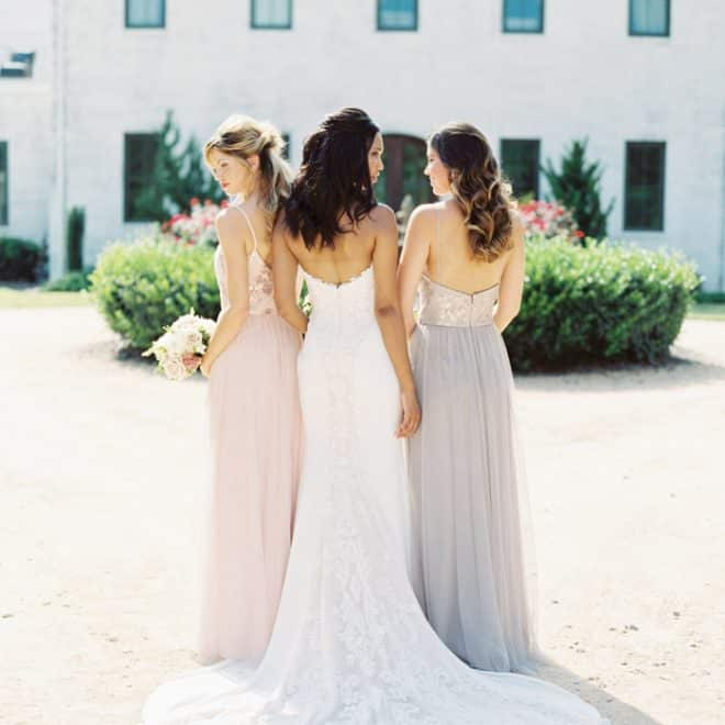 Bride and Bridesmaids show the backs of their dresses at The Bradford Bronwyn Duffield