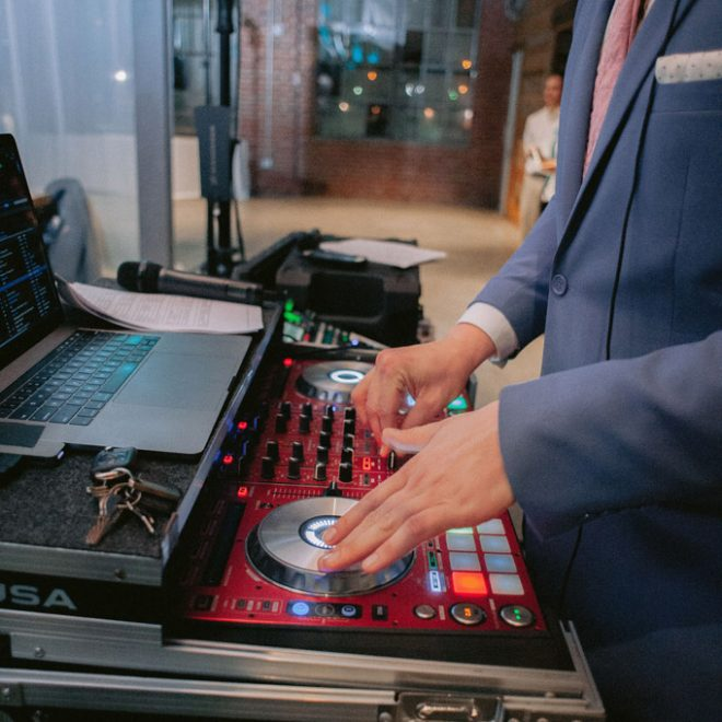 Spin NC DJ Wedding Entertainment and Music Action Shot at The Rickhouse Warehouse Venue in Durham NC Fancy This