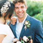 Elegant Happy Bride and Groom in Blue Suit Jewelry Hair Accessory NC Wedding Photos by Blissmore Photography