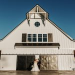 Bride and Groom Wedding Portrait Black Doors and White Barn The Carolina Barn Rustic Farm NC Wedding Venue Caddell