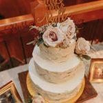Edible Art NC Wedding Cake with White Frosting and Vintage Pink Roses 3 Sarah Joann Photography