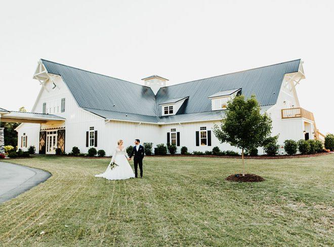 White Barn Wedding Venue Bride Groom on Green Lawn The Carolina Barn Rustic Farm NC Wedding Venue Caddell