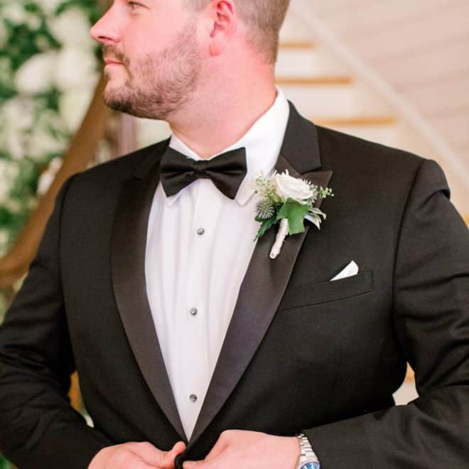 Groom in Black and White Tuxedo Bow Tie from Bernard's Formalwear Wedding Attire Petal and Oak Boutonniere Sammie B