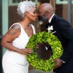 Bride and Groom Green Wreath Virtue Events Full Service Wedding Coordination and Design Morgan Crutchfield